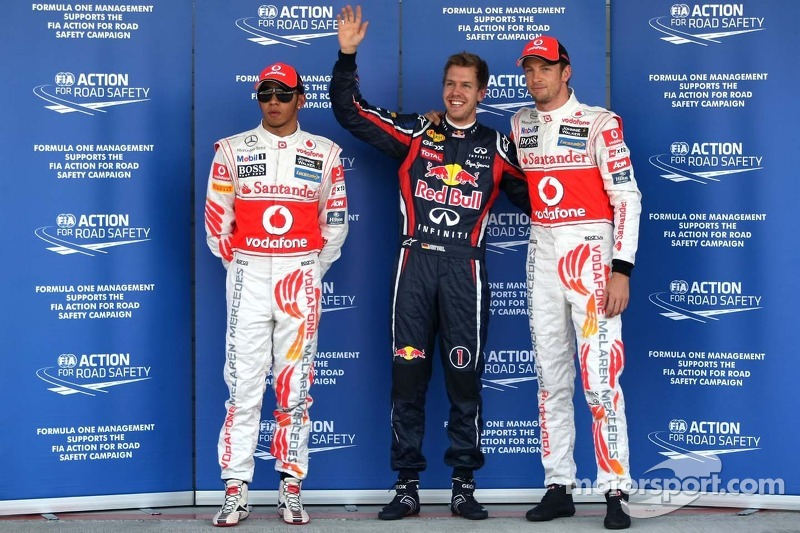 Third place Lewis Hamilton, McLaren Mercedes, pole winner Sebastian Vettel, Red Bull Racing and seco