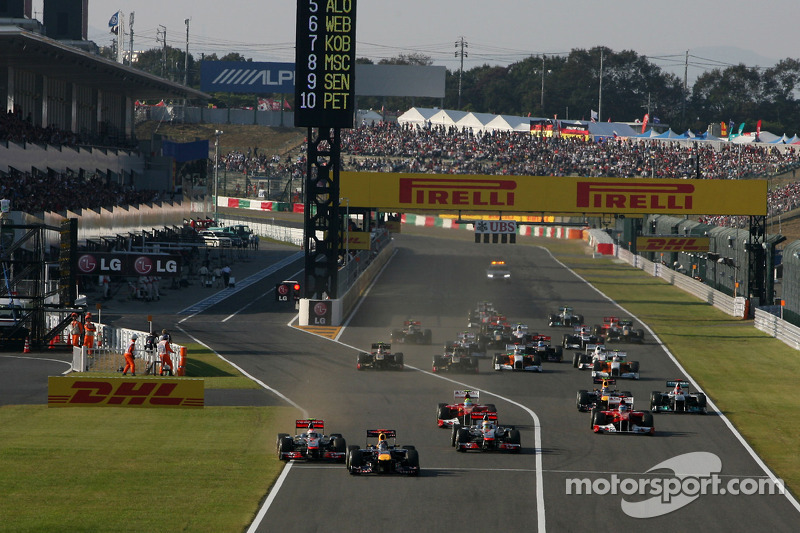 Start of the race, Sebastian Vettel, Red Bull Racing and Jenson Button, McLaren Mercedes