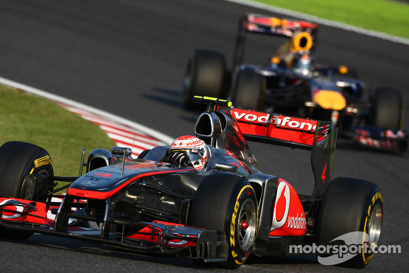 Jenson Button, McLaren Mercedes leads Sebastian Vettel, Red Bull Racing