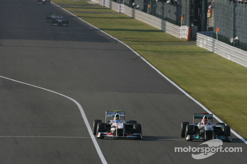 Sergio Perez, Sauber F1 Team and Michael Schumacher, Mercedes GP