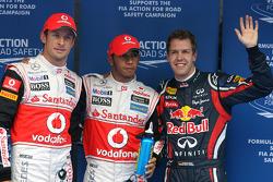 Ganador de la pole Lewis Hamilton, McLaren Mercedes, segundo lugar Sebastian Vettel, Red Bull Racing