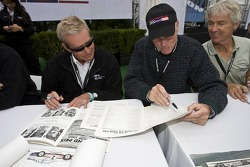 Hurley Haywood and Rob Dyson review old documents from Can-Am history brought by a fan