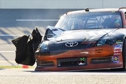 A blown tire for Kyle Busch, Joe Gibbs Racing Toyota