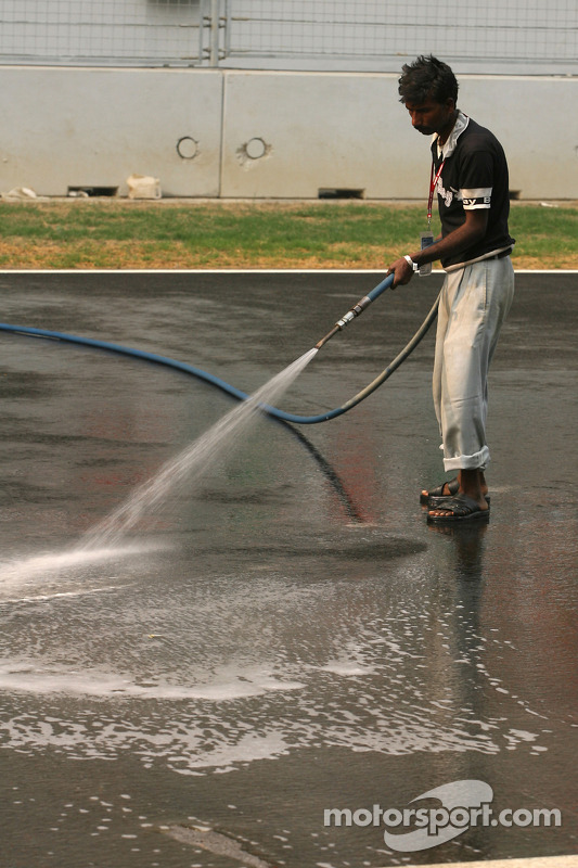 Track atmosphere, a man cleans the track