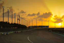 Brad Keselowski, Penske Racing Dodge leads the field as the sun sets