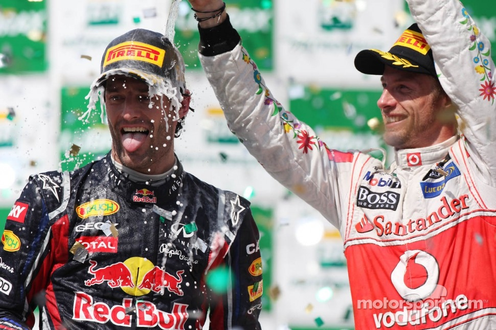 Podium: race winner Mark Webber, Red Bull Racing and third place Jenson Button, McLaren Mercedes