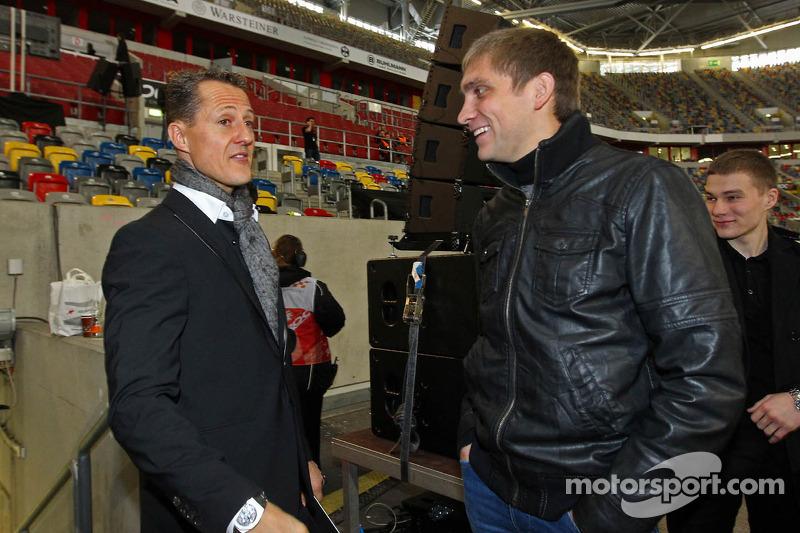 Michael Schumacher and Vitaly Petrov