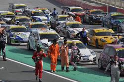 Competitors leave parc ferme