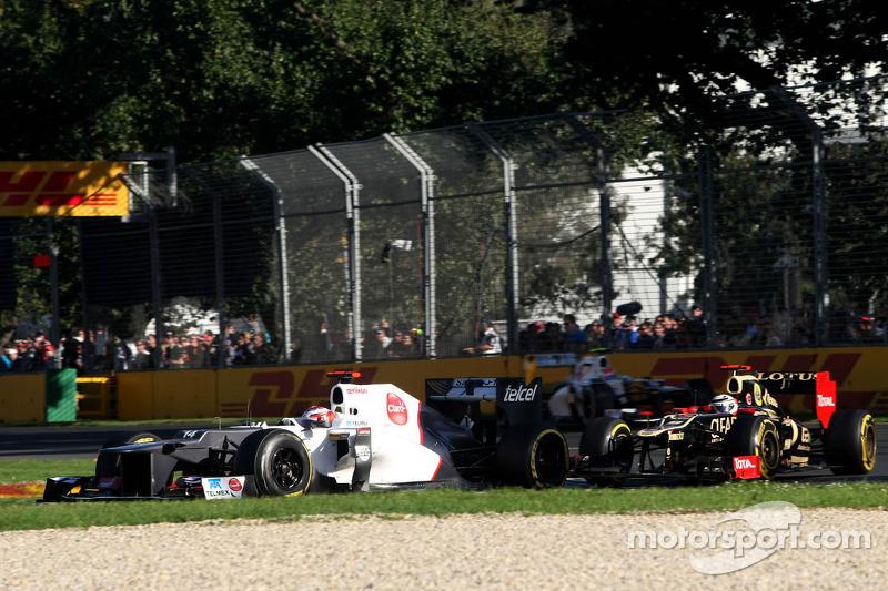 Kamui Kobayashi, Sauber F1 Team and Kimi Raikkonen, Lotus F1 Team
