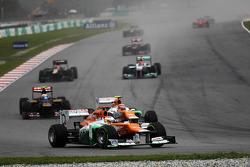 Paul di Resta, Sahara Force India leads Narain Karthikeyan, HRT Formula One Team HRT