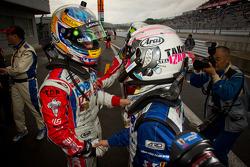 GT500 race winner Hiroaki Ishiura celebrates with Takuya Izawa