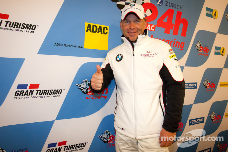 Pole winner Uwe Alzen celebrates