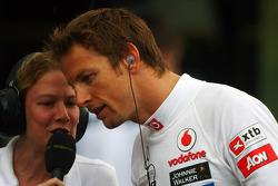 Jenson Button, McLaren Mercedes with Jenny Gow, BBC Radio 5 Live Pitlane Reporter