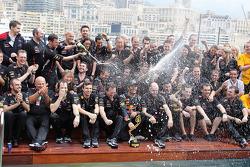Race winner Mark Webber, Red Bull Racing celebrates with the team on the Red Bull Energy Station