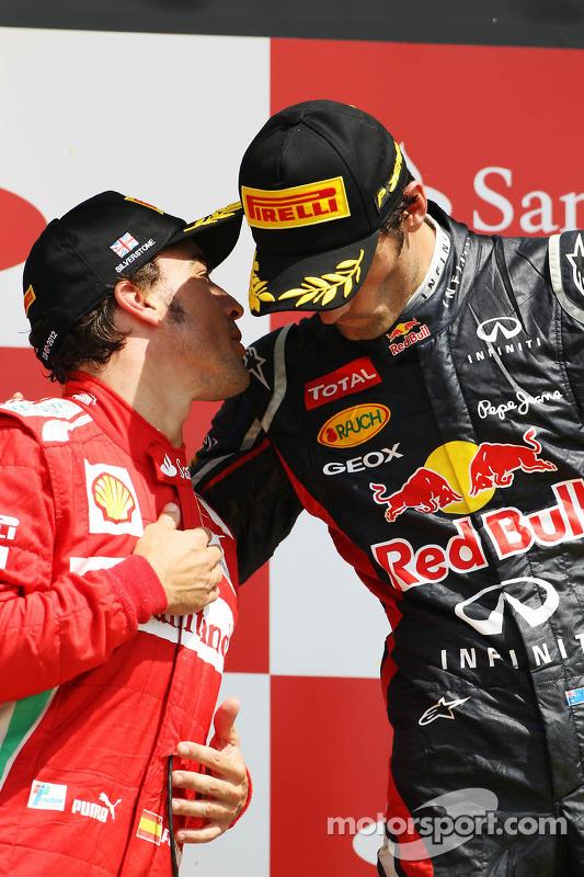 Fernando Alonso, Ferrari with race winner Mark Webber, Red Bull Racing on the podium