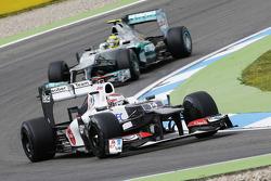 Kamui Kobayashi, Sauber leads Nico Rosberg, Mercedes AMG F1