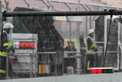 Rain falls heavily in the pits