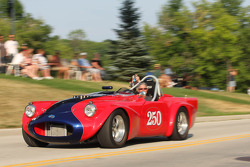 Race Cars parade into Elkhart Lake for the Friday Concours. #250 1961 Daimler SP250: Larry Ligas