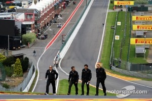 Pedro De La Rosa, HRT Formula 1 Team walks the circuit and climbs Eau Rouge