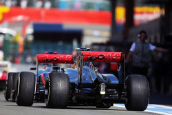 Jenson Button, McLaren and Lewis Hamilton, McLaren leaves the pits