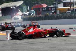 A crash at the start involving Fernando Alonso, Ferrari