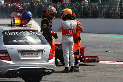 Romain Grosjean, Lotus F1 Team and Lewis Hamilton, McLaren talk after they were involved in a crash at the start