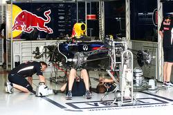 Red Bull Racing mechanics work on the Red Bull Racing