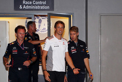 Jenson Button, McLaren and Sebastian Vettel, Red Bull Racing leave the Stewards office after the race