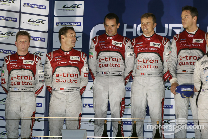 Overall podium: winners Marcel Fässler, Benoit Tréluyer, Andre Lotterer, second place Tom Kristensen, Allan McNish