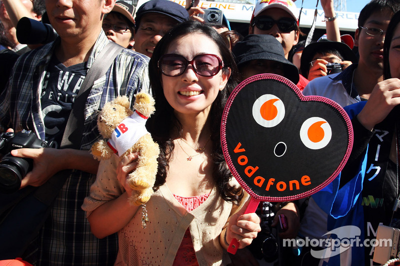 A Jenson Button, McLaren fan at the pit lane walkabout