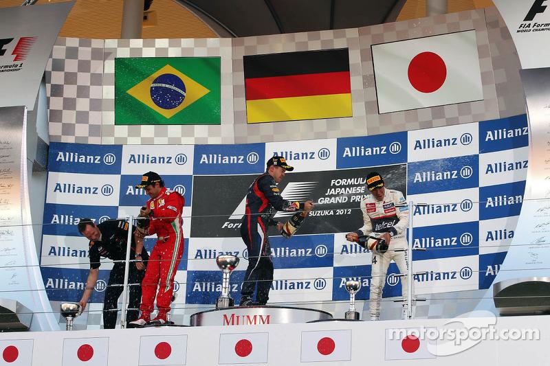 Eerste plaats Sebastian Vettel, Red Bull Racing, 2de Felipe Massa, Scuderia Ferrari en 3de Kamui Kob