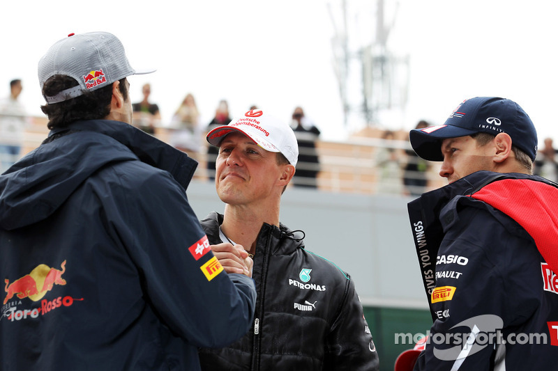 Daniel Ricciardo, Scuderia Toro Rosso with Michael Schumacher, Mercedes AMG F1 and Sebastian Vettel,