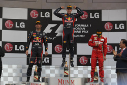1st place Sebastian Vettel, Red Bull Racing 2nd place Mark Webber, Red Bull Racing and 3rd place Fernando Alonso, Scuderia Ferrari