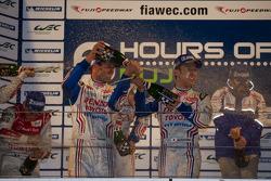 Alexander Wurz and Kazuki Nakajima celebrate