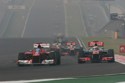 Fernando Alonso, Ferrari and Jenson Button, McLaren battle for position
