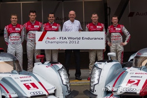 Audi drivers pose with Dr. Wolfgang Ullrich celebrating their overall FIA WEC Championship win. Drivers from left to right: Marcel Fässler, Andre Lotterer, Benoit Tréluyer, Tom Kristensen, Allan McNish