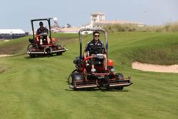 Rick Kelly drives a lawn mower