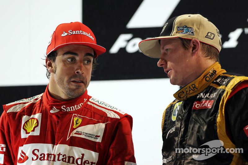 Fernando Alonso, Ferrari with race winner Kimi Raikkonen, Lotus F1 Team on the podium