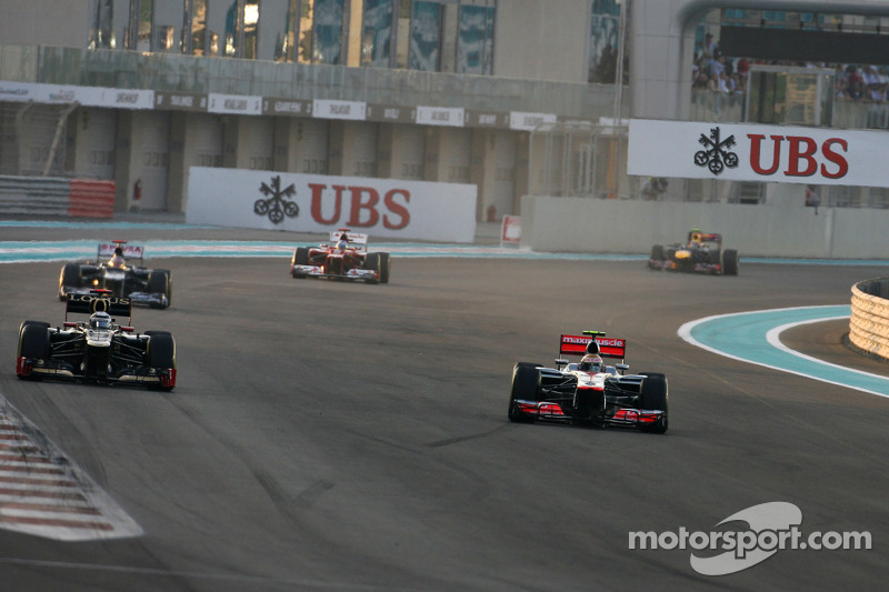 Kimi Raikkonen, Lotus F1 Team en Lewis Hamilton, McLaren Mercedes
