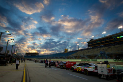 Cars lined up for qualifying under a spectacular sky