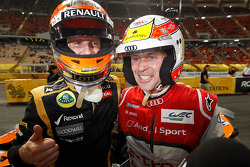 Winner Romain Grosjean celebrates with second place Tom Kristensen