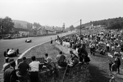 Ricardo Rodriguez leads his Ferrari team-mate Phil Hill into Eau Rouge