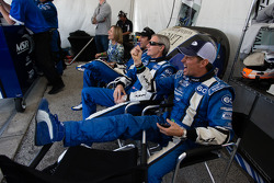 Justin Wilson, John Pew and Justin Wilson and Oswaldo Negri watch as A.J. Allmendinger takes the the lead with one hour to go