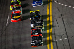 Johnny Sauter leads the field with one lap to go
