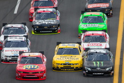 Tony Stewart, Sam Hornish Jr. and Kyle Busch battle