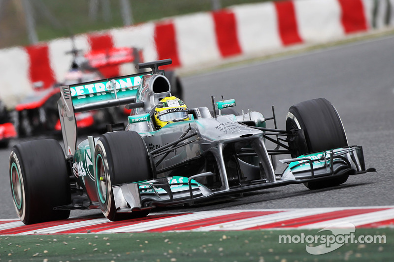 Nico Rosberg, Mercedes AMG F1 W04 leads Jenson Button, McLaren MP4-28