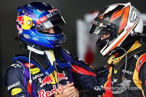 Race winner Kimi Raikkonen, Lotus F1 Team celebrates in parc ferme with Sebastian Vettel, Red Bull Racing