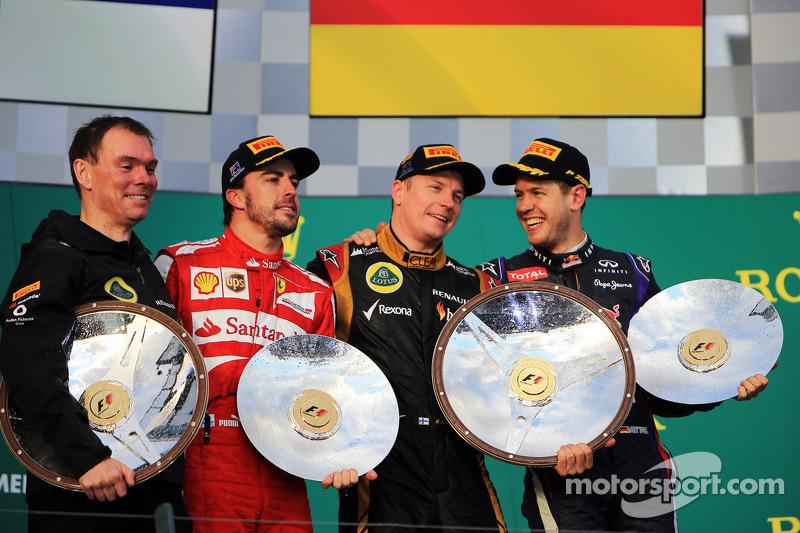 The podium, Renault Race Engineer; Fernando Alonso, Ferrari, second; Kimi Raikkonen, Lotus F1 Team, race winner; Sebastian Vettel, Red Bull Racing, third