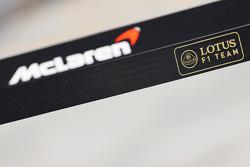 Lotus F1 Team and McLaren logos
