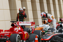Kimi Raikkonen, Lotus F1 E21 and Paul di Resta, Sahara Force India VJM06 in parc ferme